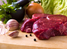 Beef steak raw with herbs Royalty Free Stock Photos