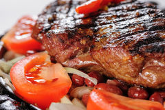 Beef steak with red beans garnish stock image