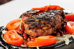Beef steak with red beans garnish stock images