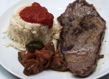 Beef steak with rice and tomato salad. Image of Beef steak with rice and tomato salad Royalty Free Stock Photography