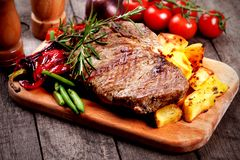 Beef steak with roasted potato stock images