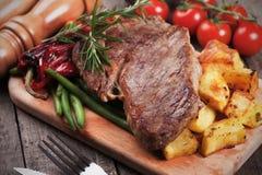 Beef steak with roasted potato Stock Photos