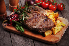 Beef steak with roasted potato. Beef rib-eye steak with roasted potato and vegetables Stock Image