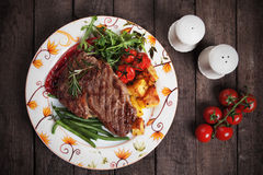 Beef steak with roasted potato and vegetables. Beef rib-eye steak with roasted potato and vegetables Stock Photo