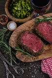 Beef steak with roasted potatoes Royalty Free Stock Images