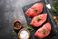 Beef steak with rosemary and spices on black background Royalty Free Stock Photos