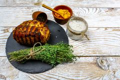 Beef steak on a round shale board with herbs and seasonings. on wooden board. top flat view. Food concept background. copy text stock images