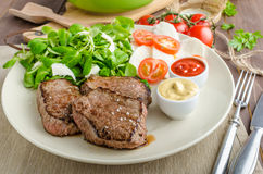 Beef steak with salad Royalty Free Stock Photos