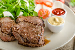 Beef steak with salad Stock Images