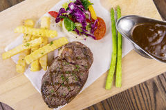 Beef steak with salad and sauce Stock Image