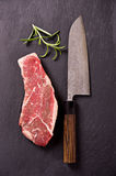 Beef Steak with Santoku Knife Royalty Free Stock Photography