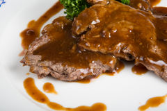 Beef steak with sauce. Asian style beef steak with gravvy sauce Stock Images