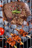 Beef steak with sausages on grill Stock Photography