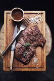 Beef steak, seasoning and sauce Stock Images