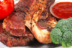 Beef steak served with vegetables Stock Photo