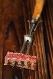 Beef steak Slice on vintage meat fork Royalty Free Stock Images