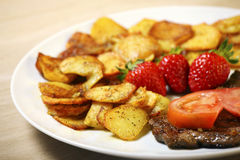 Beef steak with sliced potatoes Stock Photography