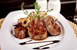 Beef steak with soy sauce, rosemary and onion Royalty Free Stock Photography