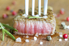Beef steak with spices on board Stock Image