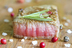 Beef steak with spices on board Stock Photos