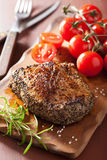 Beef steak with spices and rosemary on wooden background Stock Photography