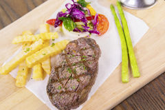 Beef steak with spices and salad Stock Images