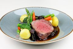 Beef steak with sesonal vegetables close up. stock photos
