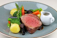 Beef steak with sesonal vegetables close up. stock photography