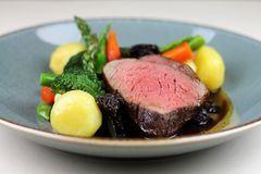 Beef steak with sesonal vegetables close up. stock images