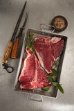 Beef steak t-bone with vintage meat fork Royalty Free Stock Image