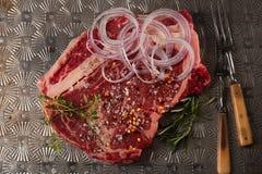 Beef steak t-bone with vintage meat fork. On metal backdrop stock images
