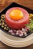 Beef steak tatare with egg, onion, cucumber and capers Royalty Free Stock Photo