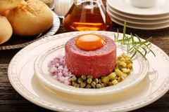 Beef steak tatare with egg, onion, cucumber and capers Stock Image