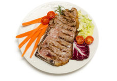 Beef Steak and vegetable garnish Stock Images