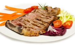 Beef Steak and vegetable garnish Royalty Free Stock Photos