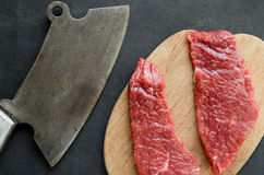 Beef steak with vintage cleaver Stock Image