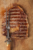 Beef steak with vintage meat fork Royalty Free Stock Image