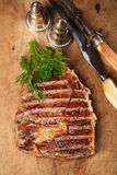 Beef steak with vintage meat fork Royalty Free Stock Images