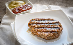 Beef steak on the white square plate Royalty Free Stock Photography