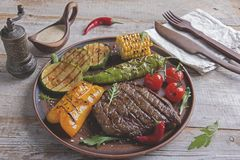 Free Beef Steak With Grilled Vegetables Stock Photography - 122044102