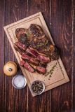 Beef steak on  a wooden background Royalty Free Stock Images