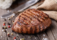 Beef steak on a wooden board Stock Photos