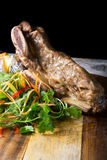Beef steak on wooden board Royalty Free Stock Photos
