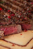 Beef steak on a wooden board and table Royalty Free Stock Images