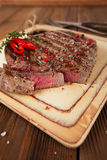 Beef steak on a wooden board and table Stock Images