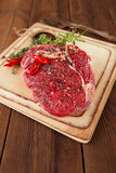Beef steak on a wooden board and table Stock Photos