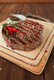 Beef steak on a wooden board and table Royalty Free Stock Photo