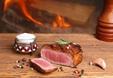 Beef steak on a wooden table Royalty Free Stock Images
