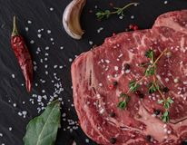 Beef steak on wooden table Royalty Free Stock Photography