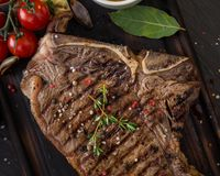 Beef steak on wooden table Stock Image